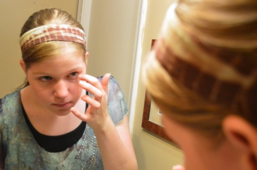 Applying a modest amount of makeup
