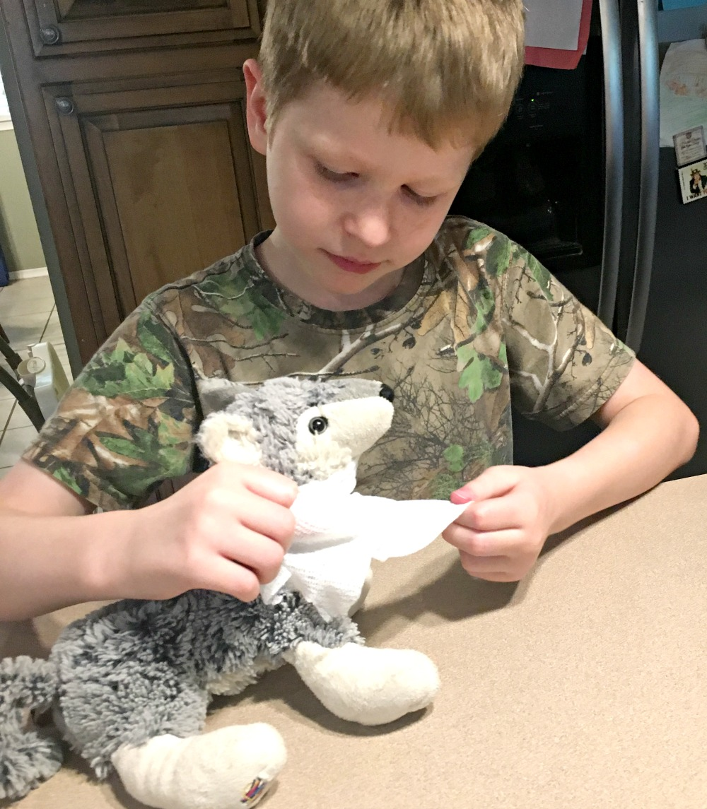 Learning to care for cuts and scrapes with our stuffed animals and The Peaceful Preschool curriculum in this week's Large Family Homeschooling Week in Review!